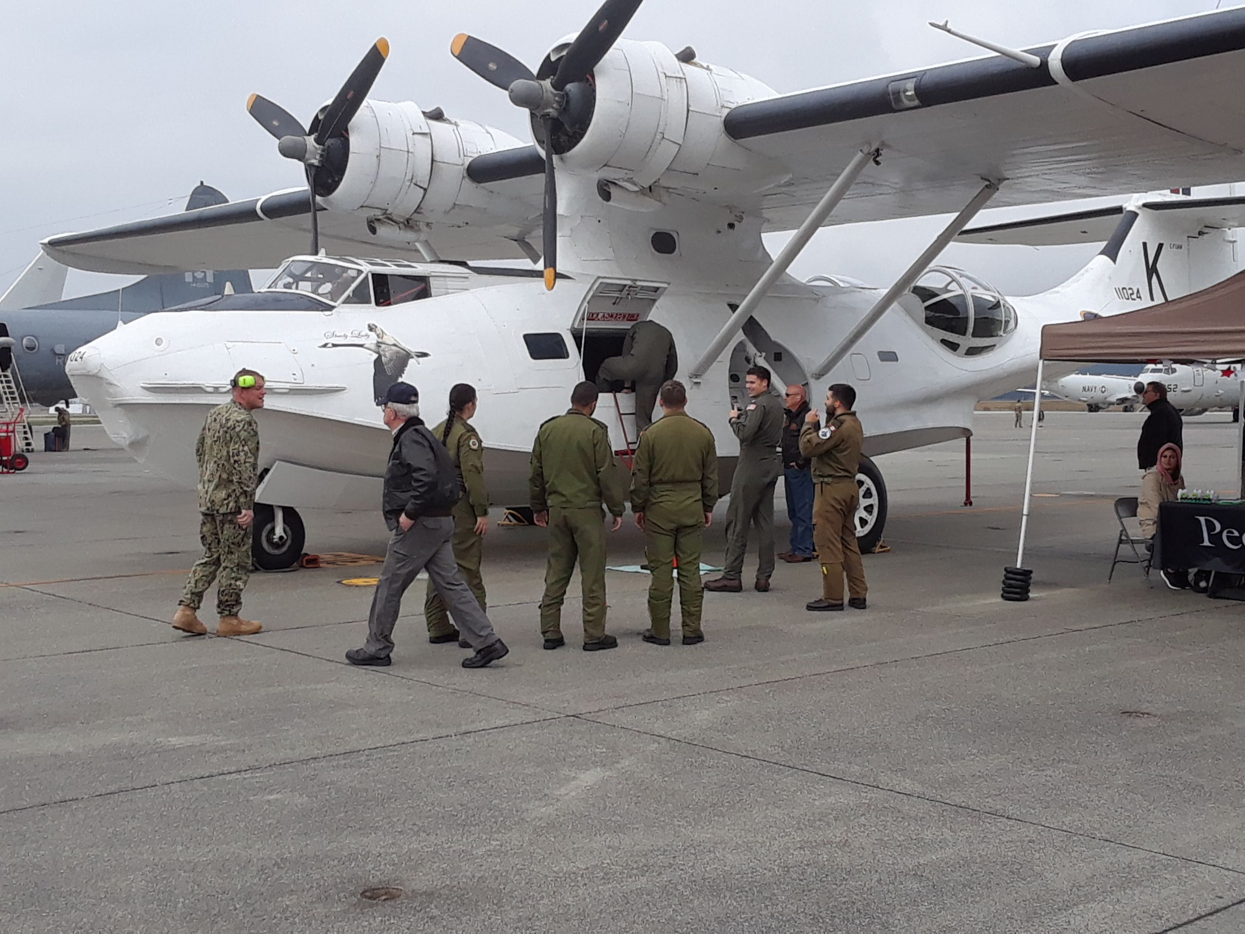 Visitors gathering around a PBY aircraft