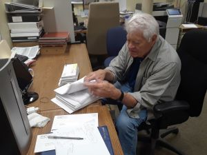 Don Growe sorting mail
