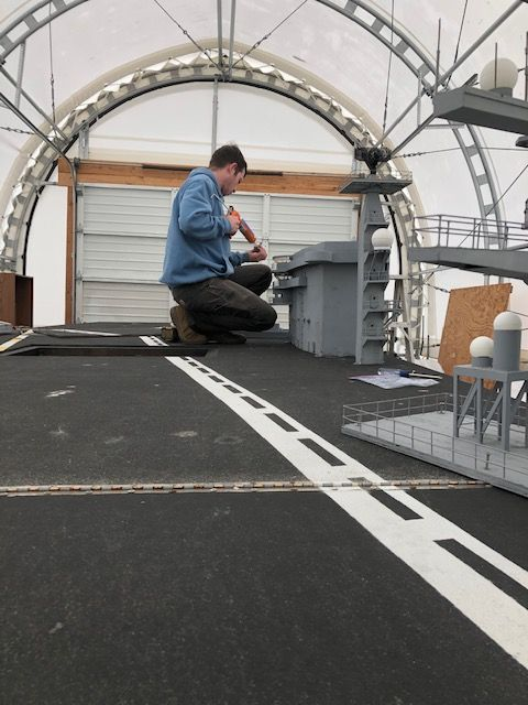 Clayton Hively working on Nimitz-Class parade aircraft carrier