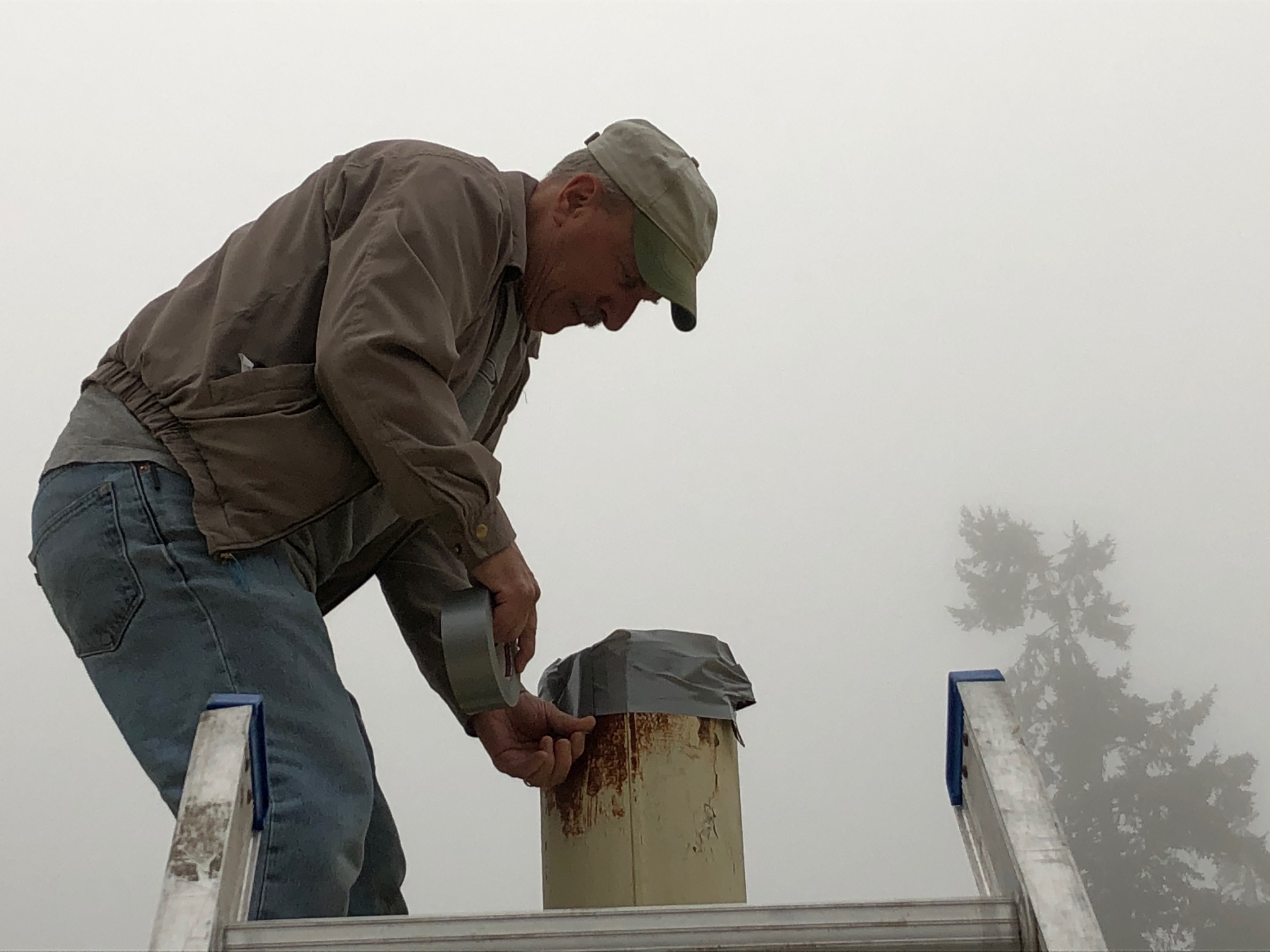 John Love doing maintenance work on the quonset hut